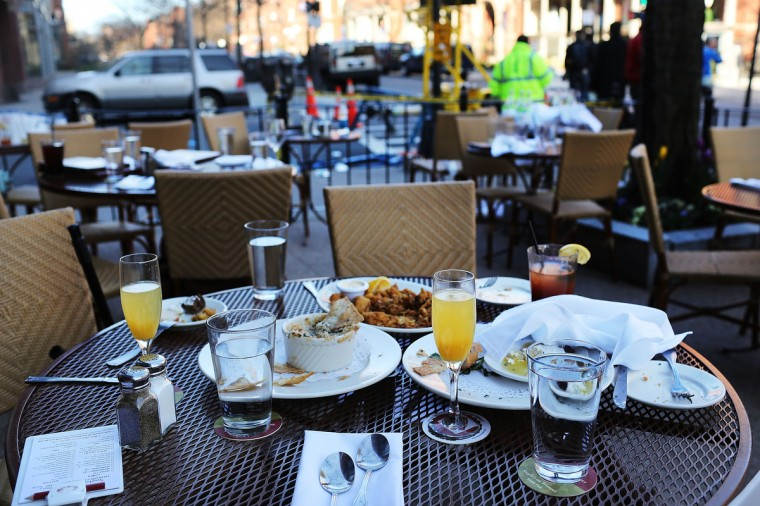 The unfinished meals of fleeing customers are left on tables at an outdoor restaurant near the scene of a twin bombing at the Boston Marathon in Boston, Massachusetts. The twin bombings, which occurred near the marathon finish line, resulted in the deaths of three people while hospitalizing at least 128. The bombings at the 116-year-old Boston race, resulted in heightened security across the nation with cancellations of many professional sporting events as authorities search for a motive to the violence. (Spencer Platt/Getty Images)