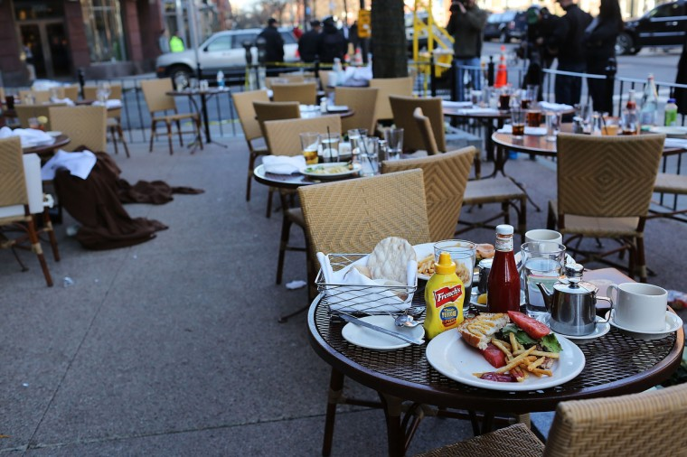 The unfinished meals of fleeing customers are left on tables at an outdoor restaurant near the scene of a twin bombing at the Boston Marathon on April 16, 2013 in Boston, Massachusetts. The twin bombings, which occurred near the marathon finish line, resulted in the deaths of three people while hospitalizing at least 128. The bombings at the 116-year-old Boston race, resulted in heightened security across the nation with cancellations of many professional sporting events as authorities search for a motive to the violence. ((Spencer Platt/Getty Images)