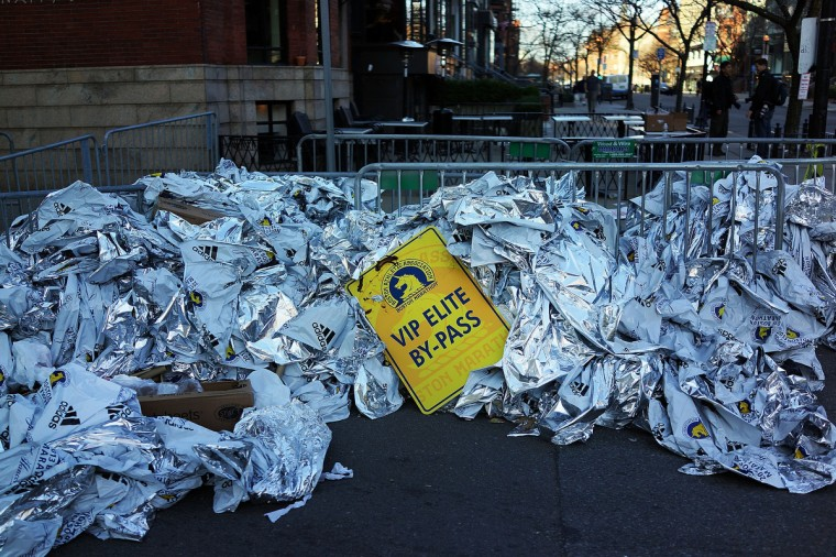 Unused thermal blankets for marathon participants are piled near the scene of a twin bombing at the Boston Marathon on April 16, 2013 in Boston, Massachusetts. The twin bombings, which occurred near the marathon finish line, resulted in the deaths of three people while hospitalizing at least 128. The bombings at the 116-year-old Boston race, resulted in heightened security across the nation with cancellations of many professional sporting events as authorities search for a motive to the violence. (Spencer Platt/Getty Images)
