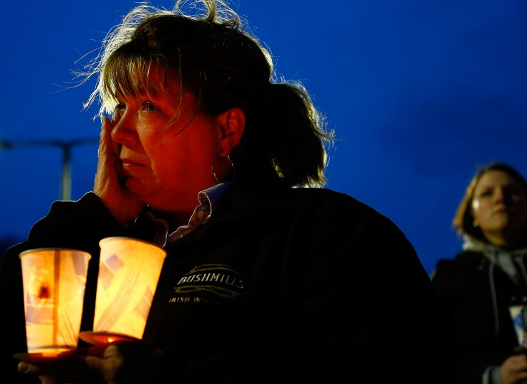 A woman cries while listening during the vigil for eight-year-old Martin Richard, from Dorchester, who was killed by an explosion near the finish line of the Boston Marathon on April 16, 2013 at Garvey Park in Boston, Massachusetts. The twin bombings resulted in the deaths of three people and hospitalized at least 128. The bombings at the 116-year-old Boston race resulted in heightened security across the nation with cancellations of many professional sporting events as authorities search for a motive to the violence. (Jared Wickerham/Getty Images)