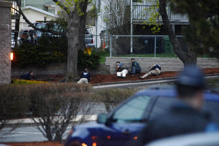 Law enforcement approach an area reportedly where a suspect is hiding on April 19, 2013 in Watertown, Massachusetts. three people and wounded at least 170. (Darren McCollester/Getty Images)