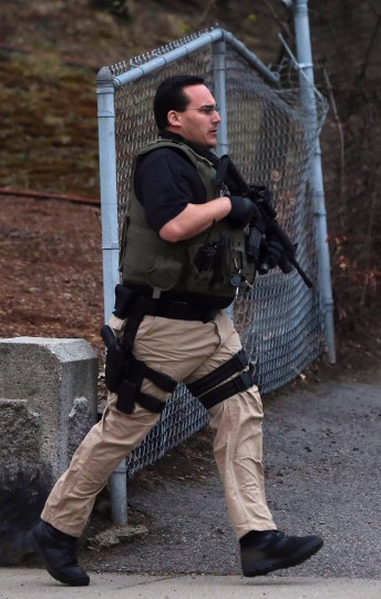 A police officer responds to a reported shooting on April 19, 2013 in Watertown, Massachusetts. (Mario Tama/Getty Images)