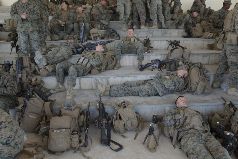 U.S. Marine soldiers from 3rd Marine Expeditionary force landing team deployed from Okinawa, Japan, rest during the CJLOTS (Combined Joint Logistics Over The Shore) exercise in Pohang, South Korea. The operation, part of annual 2-month Foal Eagle exercise, while the tension at Korean Peninsula remains high as North Korea's ballistic missiles have been ready to launch. (Chung Sung-Jun/Getty Images)