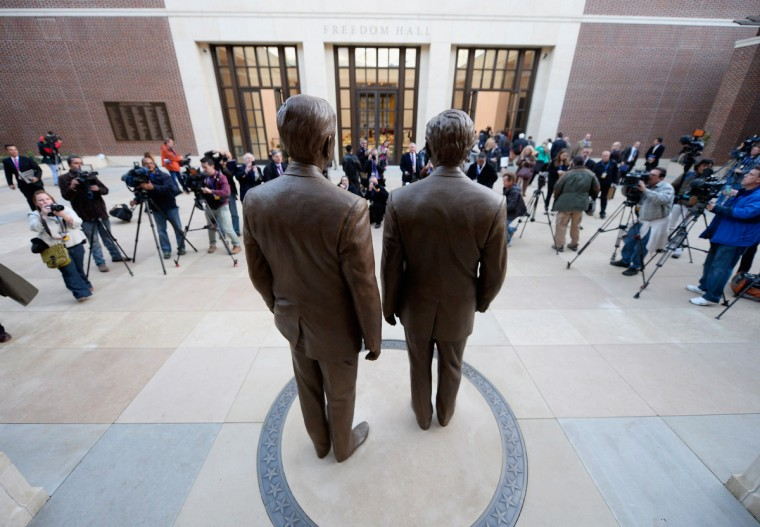 Statues of former Presidents George W. Bush (R) and his father George H.W. Bush are on display during a tour of the George W. Bush Presidential Center on the campus of Southern Methodist University on April 24, 2013 in Dallas, Texas. (Kevork Djansezian/Getty Images)