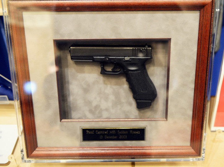 A pistol captured with Saddam Hussein on December, 13, 2003, is displayed during a tour of the George W. Bush Presidential Center on the campus of Southern Methodist University. (Kevork Djansezian/Getty Images)