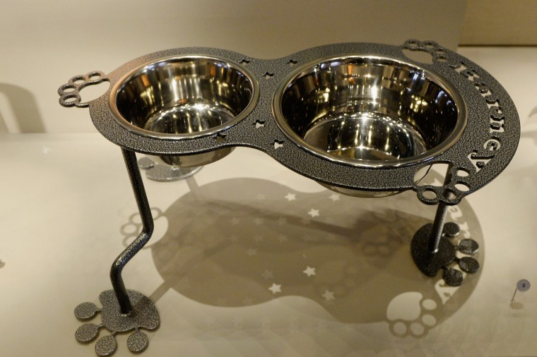 Steel dog bowls with paw shaped feet given as a gift to Presidents George W. Bush sit on display at the George W. Bush Presidential Center. (Kevork Djansezian/Getty Images)