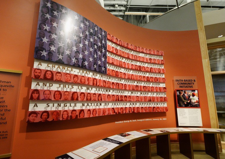 A display on the Bush administration's faith-based and community initiative is seen at the George W. Bush Presidential Center on the campus of Southern Methodist University. (Kevork Djansezian/Getty Images)