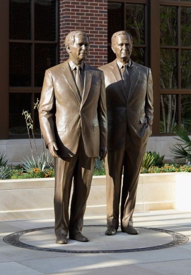 Statues of former Presidents George W. Bush (L) and his father George H.W. Bush are on display during a tour of the George W. Bush Presidential Center on the campus of Southern Methodist University. (Kevork Djansezian/Getty Images)