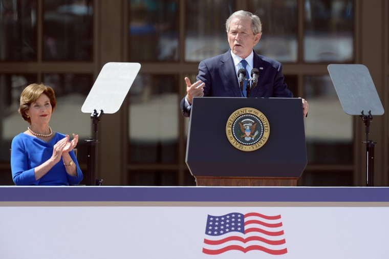 Former President George W. Bush (R) speaks as former first lady Laura Bush applauds during the opening ceremony of the George W. Bush Presidential Center. (Kevork Djansezian/Getty Images)