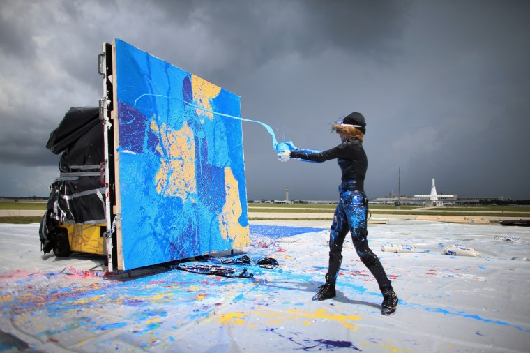 Artist Princess Tarinan von Anhalt throws paint into the flow of air coming from the engine of Flexjet's Learjet 40 XR engine to create a painting on a canvas at Signature Flight Support in West Palm Beach, Florida. The artist associated with the Jet Art Group used the help of Flexjet and their plane to spray paint on a canvas to create distinctive paintings to celebrate the 50th anniversary of Learjet. (Joe Raedle/Getty Images)