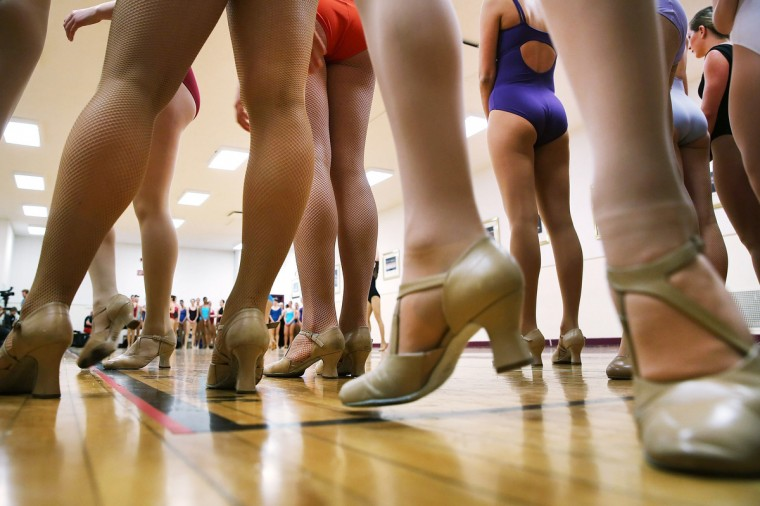 Women audition at Radio City Music Hall for a spot with the Rockettes in New York City. In order to be considered for the Rockettes, dancers must be at least 18 years old, measure at a height between 5 feet 6 inches and 5 feet 10 1/2 inches without their heels on. The dancers must also be be proficient in numerous dance styles, including jazz, tap and ballet. The women who make it through the extremely competitive competition to land a spot with the legendary dance group will perform in the Radio City Christmas Spectacular which runs from November 8 -December 30 2013. (Spencer Platt/Getty Images)