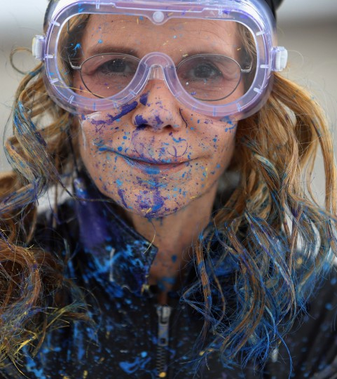 Artist Princess Tarinan von Anhalt poses, covered in paint, as she works on a piece of art using the air flow coming from the engine of Flexjet's Learjet 40 XR engine at Signature Flight Support in West Palm Beach, Florida. The artist associated with the Jet Art Group used the help of Flexjet and their plane to spray paint on a canvas to create distinctive paintings to celebrate the 50th anniversary of Learjet. (Joe Raedle/Getty Images)