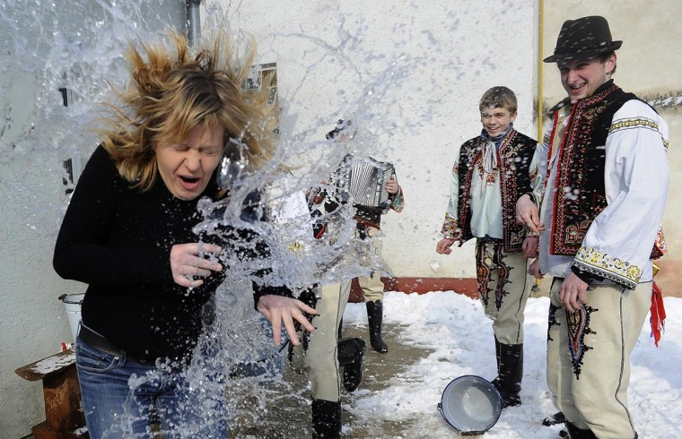 Young Slovak men dressed in traditional costumes pour a bucket with cold water over a woman as part of Easter celebrations in the village of Trencianska Tepla on April 1, 2013. Slovakia's men traditionally splash women with water and hit them with a willow to evoke youth, strength and beauty for the upcoming spring season. (Samuel Kubani/AFP/Getty Images)