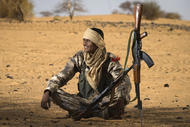 A Malian Special Force soldier sits during the Operation Gustav, a hunt for Islamist fighters in a valley in northern Mali and one of France's largest military operations during its three-month intervention in its former colony, 105 km North of Gao. Operation Gustav comes with France preparing to withdraw three-quarters of the 4,000 troops it deployed in January to block a feared advance on the Malian capital Bamako by Al Qaeda-linked insurgents. (Joel Saget/Getty Images)