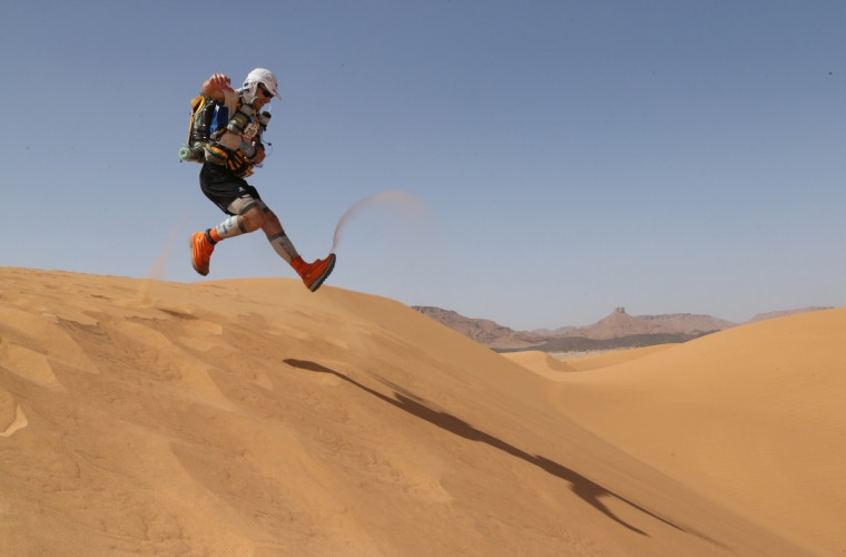 "A competitor runs on a dune during the 28th edition of the ""Marathon des Sables"", some 300 kms south of Ouarzazate. The 223,8 kms Desert Marathon is considered as the hardest in the world. About 1024 participants, from 45 nationalities and aged 20 to 76, have to walk during seven days in the Moroccan Sahara and carry all their equipment and food on their backs. (Pierre Verdy/Getty Images)"