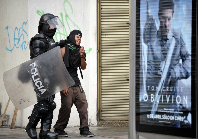 A student is arrested by a riot policeman during a protest in Bogota, Colombia. Students demand government to improve the public education quality. (Guillermo Legaria/Getty Images)