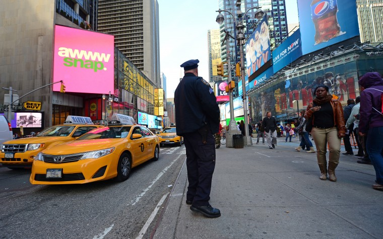 A policeman mans his post at New York's Times Square after security was boosted following blasts that occured at the finish line of the Boston marathon, in New York, April, 15, 2013. At least two people were killed and 23 others wounded when two explosions struck near the finish line of the Boston Marathon, sparking scenes of panic. (Emmanuel Dunand/AFP/Getty Images)