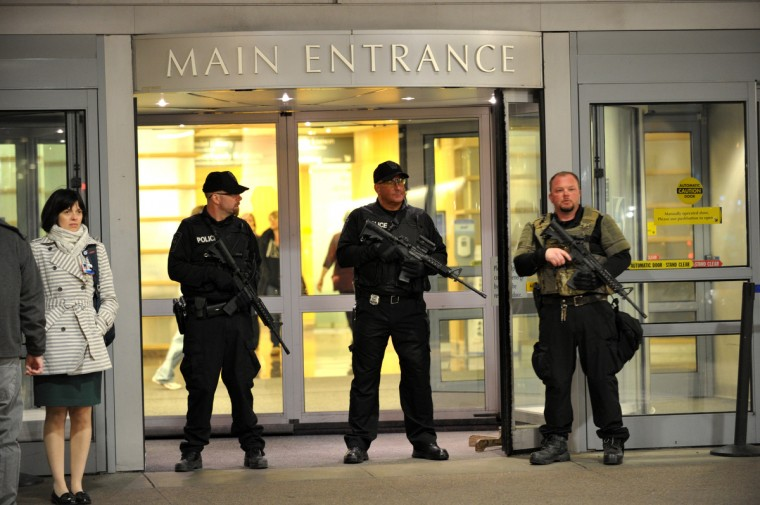 Armed police officers secure the main entrance to Bringham and Women's Hospital April 16, 2013 in Boston, Massachusetts. Many who were wounded when two explosions struck near the finish line of the Boston Marathon were brought to Bringham and Women's. (Stan Honda/Getty Images)