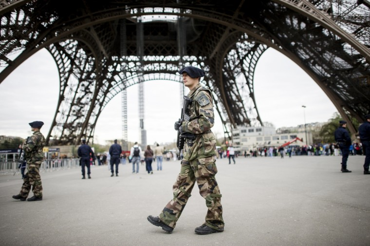 French soldiers patrol on April 16, 2013 in front of the Eiffel Tower in Paris. France on April 16 ordered police patrols to be stepped up after at least two people were killed and 23 others wounded in two explosions on April 15 near the finish line of the Boston Marathon. (Fred Dufour/Getty Images)