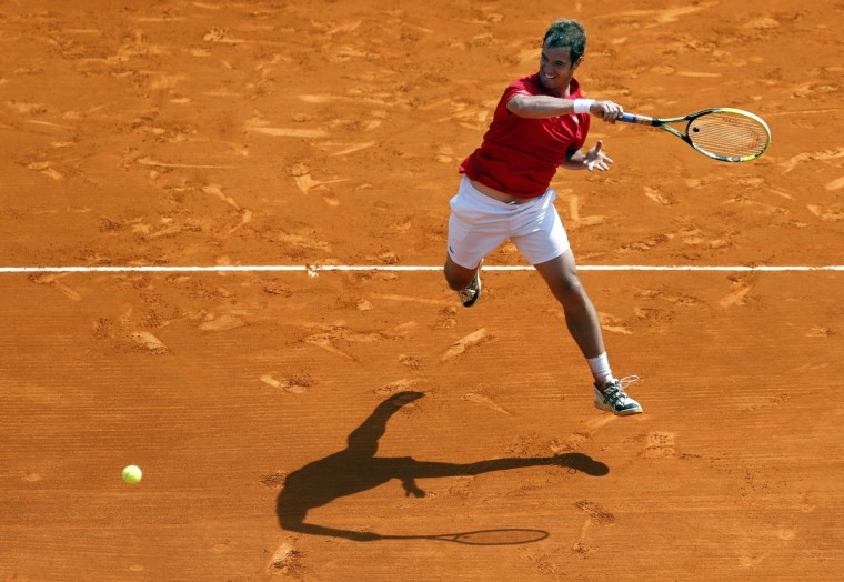 France's Richard Gasquet returns the ball to his compatriot Benoit Paire during a Monte-Carlo ATP Masters Series Tournament tennis match in Monaco. (Valery Hache/Getty Images)