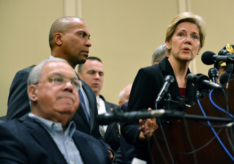 US Senator Elizabeth Warren (R),D-MA, speaks at a press conference with Massachusetts Governor Deval Patrick (C) and Boston Mayor Thomas Menino (L) April 16, 2013 in Boston, Massachusetts, in the aftermath of two explosions that struck near the finish line of the Boston Marathon April 15. The number of casualties in a Monday's bombings at the Boston marathon has risen to 176, police said Tuesday. Three people were killed. (Stan Honda/Getty Images)