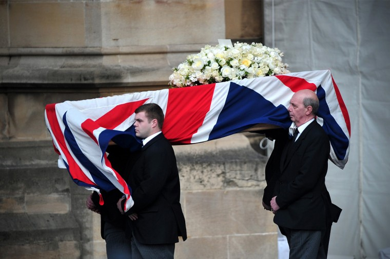 Pallbearers carry the coffin of former British prime minister Margaret Thatcher as it arrives to be laid at the Crypt Chapel of St Mary Undercoft in the Houses of Parliament in London to allow lawmakers to pay their last respects to the iron lady on the eve of her ceremonial funeral. As Thatcher requested when she planned her own funeral, her body will remain overnight in a chapel at the Palace of Westminster in central London, where she served for more than half a century in both the lower and upper houses. (Carl Court/Getty Images)