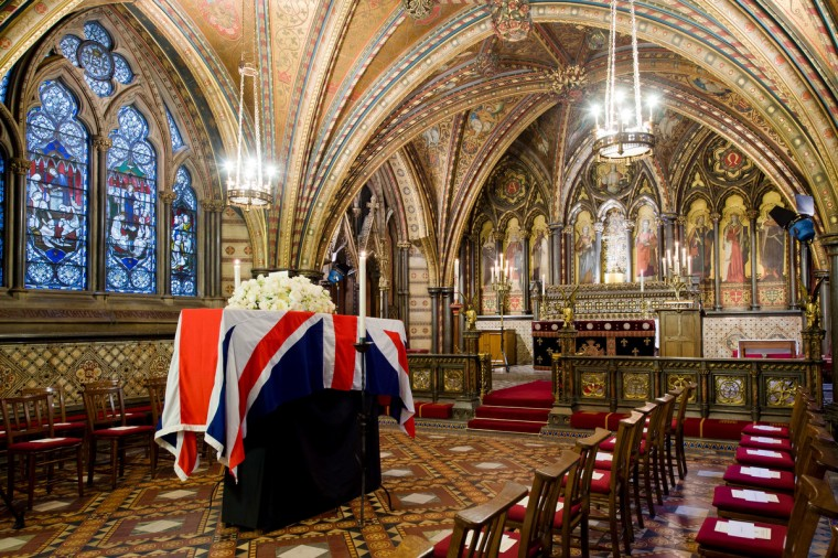 The coffin of British former prime minister Margaret Thatcher rests in the Crypt Chapel of St Mary Undercroft beneath the Houses of Parliament in central London on the eve of her ceremonial funeral. As Thatcher requested when she planned her own funeral, her body will remain overnight in the chapel at the Palace of Westminster in central London, where she served for more than half a century in both the lower and upper houses. (Leon Neal/Getty Images)
