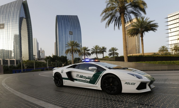 Emirati policemen patrol in an especially modified Lamborghini Aventador in the Gulf emirate of Dubai. The introduction of the sports car, which can reach speeds of up to 349 km/h (217 mph), aims to make justice quicker on Dubai's dangerous highways. (Karim Sahib/Getty Images)