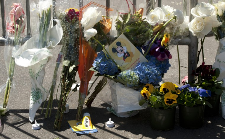 A tube of Bengay, a pain relief medicine, lays nears flowers at a memorial site at Boylston and Arlington streets along the course of the Boston Marathon on April 16, 2013, a few blocks from where two explosions struck near the finish line of the Boston Marathon on April 15. (Don Emmert/Getty Images)
