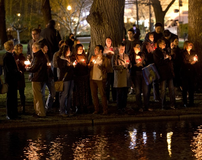 Mourners gather on the edge of the pond in the Boston Public Gardens for a candle light vigil April 16, 2013 in Boston. A few hundred people gathered to remember the victims of the bombs which exploded during the running of the Boston Marathon. (Don Emmert/AFP/Getty Images)