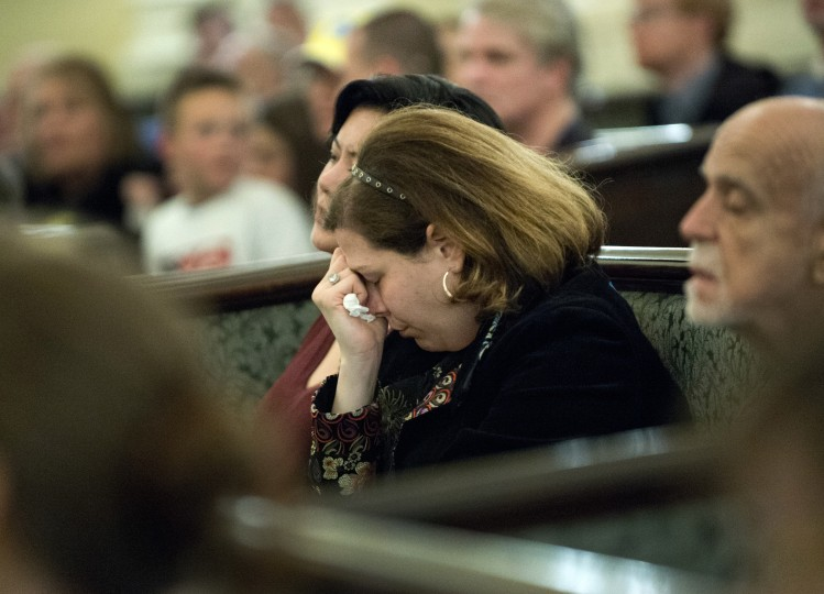 Mourners in the Arlington Street Church gather for a candle light vigil April 16, 2013 in Boston. Several hundred people gathered to remember the victims of the bomb which exploded during the running of the Boston Marathon. (Don Emmert/AFP/Getty Images)