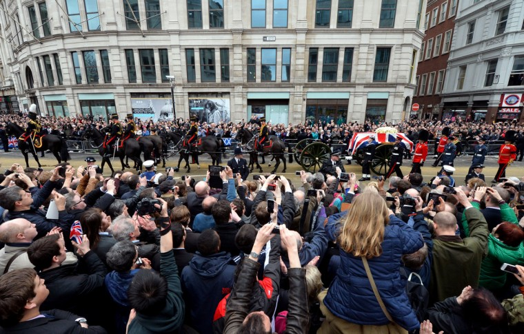 The coffin of British former prime minister Margaret Thatcher is carried on a gun carriage drawn by the King's Troop Royal Horse Artillery during her ceremonial funeral in central London. The funeral of Margaret Thatcher took place on April 17, with Queen Elizabeth II leading mourners from around the world in bidding farewell to one of Britain's most influential and divisive prime ministers. (Paul Ellis/Getty Images)