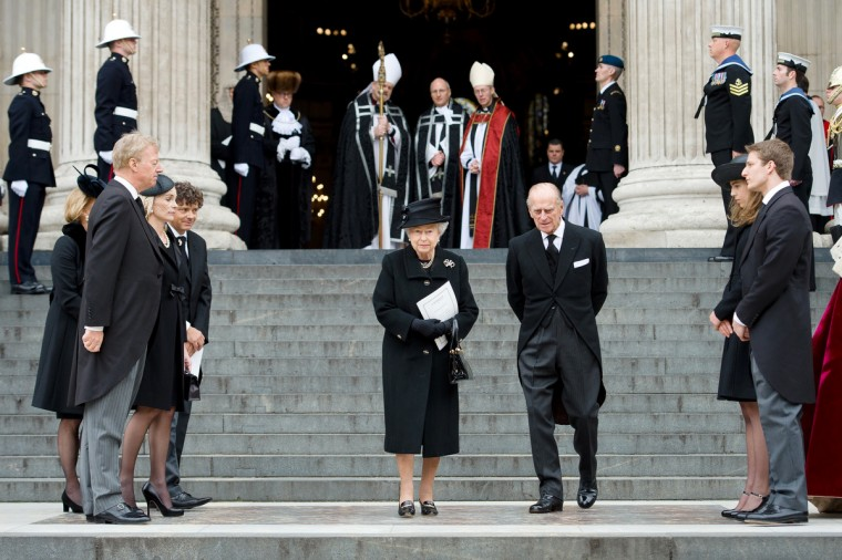 Britain's Queen Elizabeth II and Britain's Prince Philip, Duke of Edinburgh, leave St Paul's Cathedral at the end of the ceremonial funeral of British former prime minister Margaret Thatcher in central London. (Leon Neal/Getty Images)