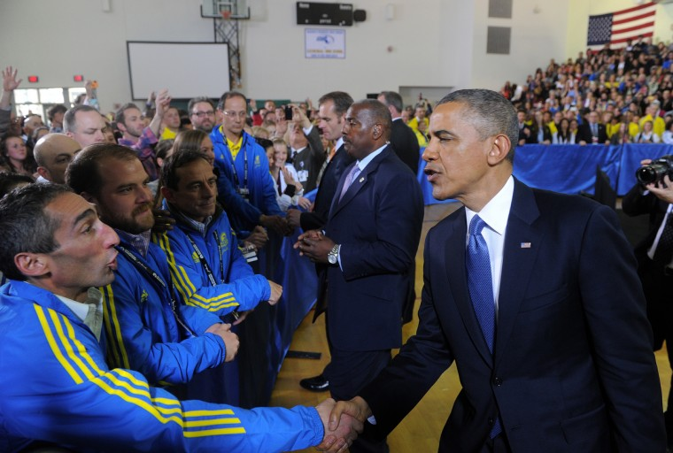 US President Barack Obama greets Boston Athletic Association volunteers in Boston, Massachusetts. Obama is in Boston to mourn victims of the deadly marathon attacks, as investigators study images of a suspect who may have planted the bombs. No arrests have been made in connection with Monday's twin bombings near the finish line of the race, which sent metal fragments and nails into a crowd of thousands of runners and spectators, killing three people and wounding 180. (Jewel Samad/Getty Images)