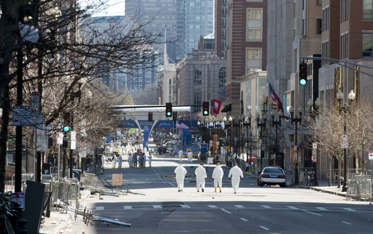 Agents continue to search for evidence on the Boston Marathon route on April 18, 2013 in Boston. (Don Emmert/Getty Images)