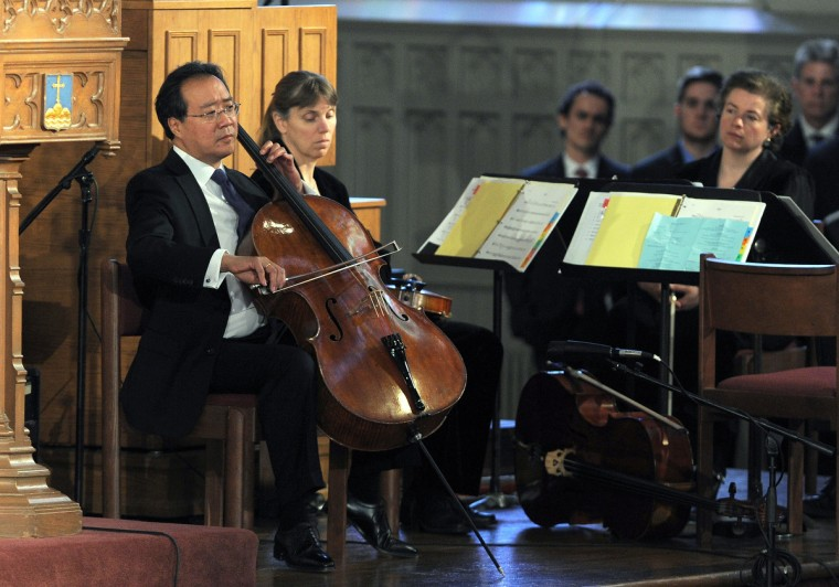 """Musician Yo-Yo Ma performs during """"Healing Our City: An Interfaith Service"""" dedicated to those who were gravely wounded or killed in the Boston Marathon bombing, at the Cathedral of the Holy Cross in Boston, Massachusetts, on April 18, 2013. (Jewel Samad/Getty Images)"""