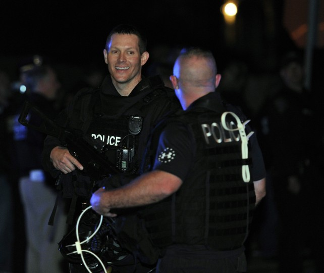 Boston Swat team members smile after the capture of the second of two suspects wanted in the Boston Marathon bombings April 19, 2013 in Watertown, Massachusetts. (Timothy Clary/Getty Images)