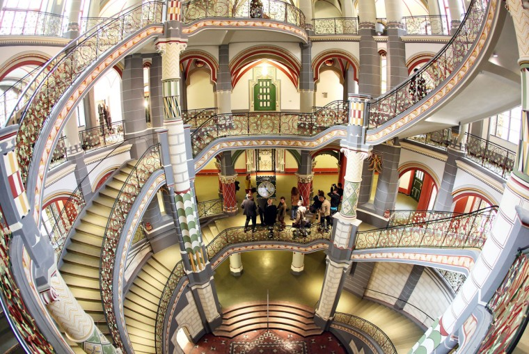 Visitors stand in the staircase of the restored former Prussian justice palace, that serves now as county court in Halle an der Saale, eastern Germany. The 110 years old building housing 20 courtrooms, 110 offices and further 100 rooms re-opened after two years of restoration. (Jan Woitas/Getty Images)