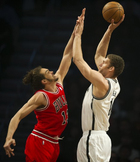Brooklyn Nets Brook Lopez (11) gets a shot off over Chicago Bulls Joakim Noah (13) during game two of their first round NBA playoff game at the Barclay Center in New York. (Don Emmert/Getty Images)