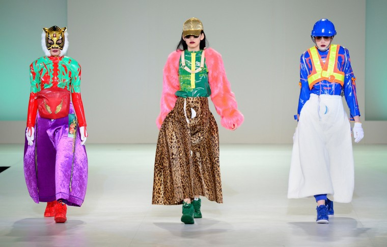 """Models present creations by Morio Deguchi during """"the Soen Prize,"""" the budding fashion designers' contest at Bunka fashion college in Tokyo. Sixteen designers took part in the competition. (Toru Yamanaka/Getty Images)"""