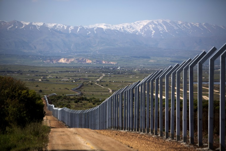 The newly built Israeli border with Syria is seen on the Israeli side of the annexed Golan Heights near Quneitra. Israel's Brigadier General Itai Brun, head of research and analysis in the army's military intelligence division, said that the Damascus regime was guilty of using chemical weapons against rebel fighters. (Menahem Kahana/Getty Images)