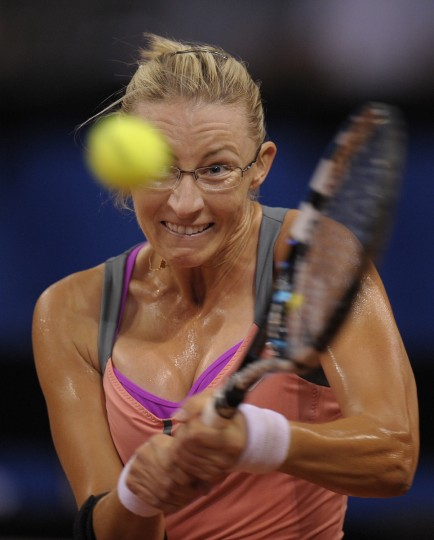 Croatia's Mirjana Lucic-Baroni returns the ball to China's Li Na in their match of the WTA Porsche Tennis Grand Prix in Stuttgart, southwestern Germany. (Thomas Kienzle/Getty Images)
