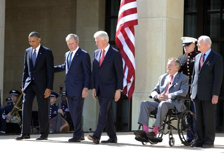 US President Barack Obama (L) and former Presidents (L-R) George W. Bush, Bill Clinton, George H.W. Bush and Jimmy Carter arrive on stage for the George W. Bush Presidential Center dedication ceremony in Dallas, Texas. (Jewel Samad/Getty Images)