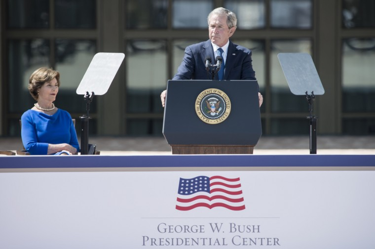Former First Lady Laura Bush listens while former US President George W. Bush speaks during a dedication ceremony at the George W. Bush Library and Museum on the grounds of Southern Methodist University April 25, 2013 in Dallas, Texas. The Bush library is dedicated to chronicling the presidency of the United State's 43rd President, George W. Bush. (Brendan Smialowski/Getty Images)