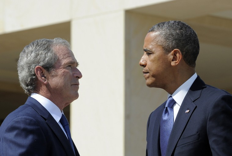US President Barack Obama (R) and former President George W. Bush shakes hands during the opening ceremony of the George W. Bush Presidential Center April 25, 2013 on the campus of Southern Methodist University (SMU)in Dallas, Texas. (Jewel Samad/Getty Images)