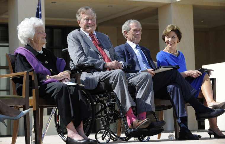 Former US President George H.W. Bush (C) and George W. Bush (2nd-R) sit with former First Ladies Barbara Bush (L) and Laura Bush (R) during the George W. Bush Presidential Center dedication ceremony in Dallas, Texas. (Jewel Samad/Getty Images)