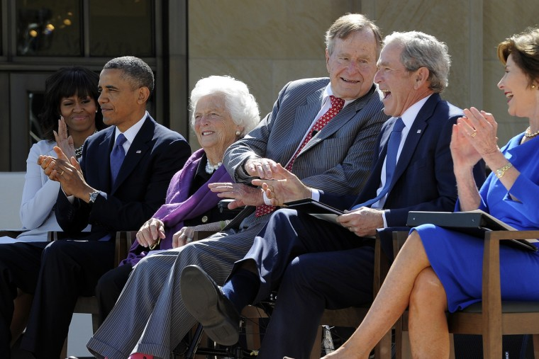 (L-R) US First Lady Michelle Obama, US President Barack Obama former First Lady Barbara Bush, former President George H.W. Bush, former President George W. Bush and former US First Lady Laura Bush laugh during the George W. Bush Presidential Center dedication ceremony in Dallas, Texas. (Jewel Samad/Getty Images)
