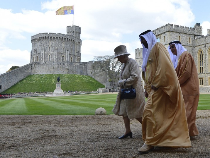 Britain's Queen Elizabeth II (L) walks and talks with Emirati President Sheikh Khalifa bin Zayed al-Nahayan (C) after a ceremonial welcome for his State visit in the grounds of Windsor Castle, in Berkshire, west of London. Sheikh Khalifa officially began a State visit to Britain with a cermonial welcome in Windsor hosted by the Queen and the Duke of Edinburgh. (Toby Melville/Getty Images)