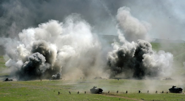 Servicemen of Georgia's army take part in a military drill as they mark Georgian Army Day at Vaziani military base outside Tbilisi. (Vano Shlamov/Getty Images)