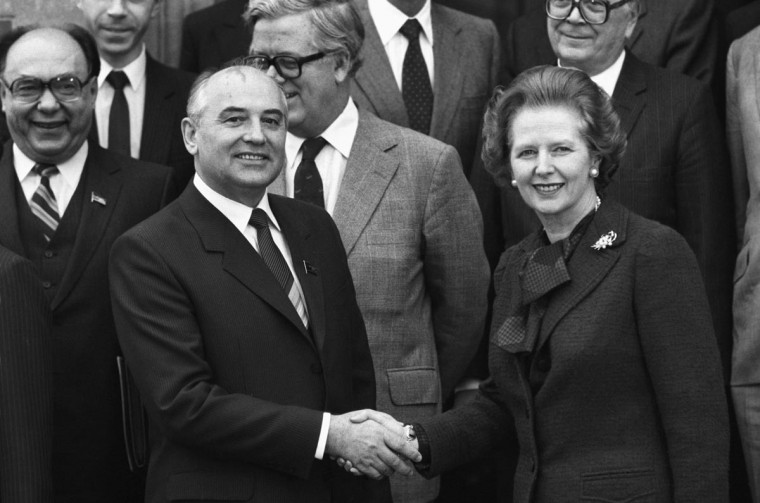Soviet Politburo member Mikhail Gorbachev shakes hands with British Prime Minister Margaret Thatcher at Chequers on December 16, 1984. (Terry Disney/Express/Getty Images)